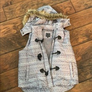 Limited puffer vest with fake fur trimmed hood